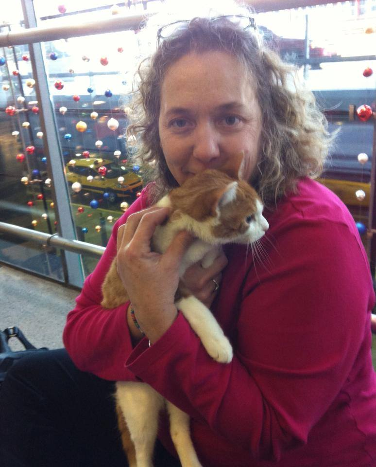 Ginger, a Manx Syndrome kitty, and her transporter, Karen at O'Hare Airport, getting ready to fly to Vegas.